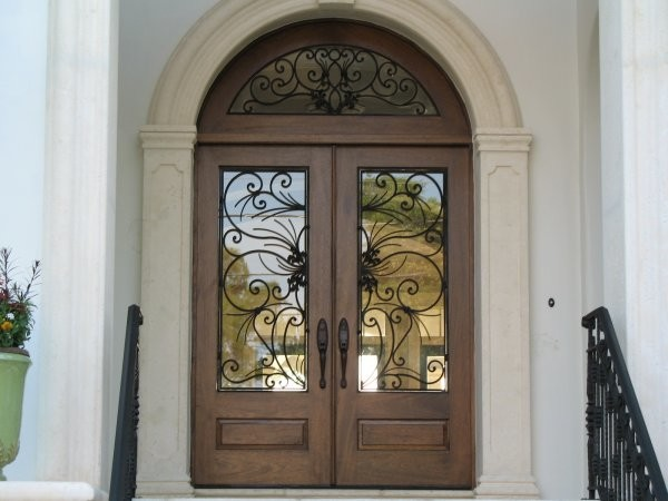 Elegant mahogany and glass arch double front door home for Houses with double front doors