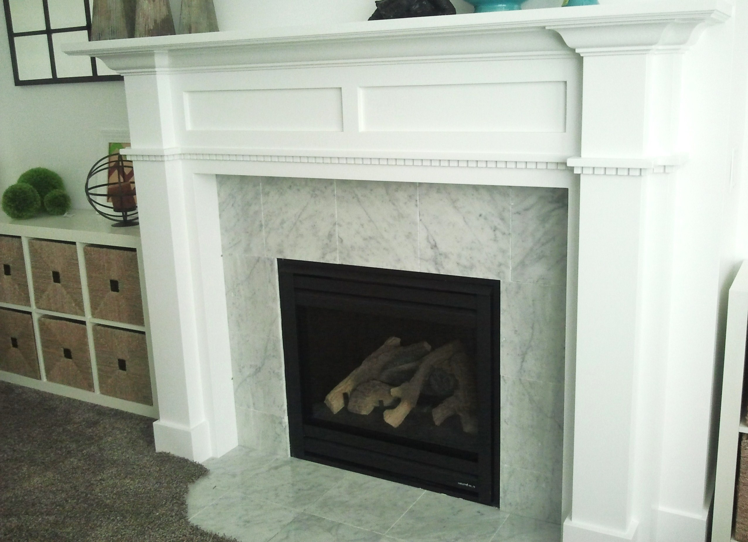 Marble fireplace surround ideas bring a warm for Marble for fireplace surround