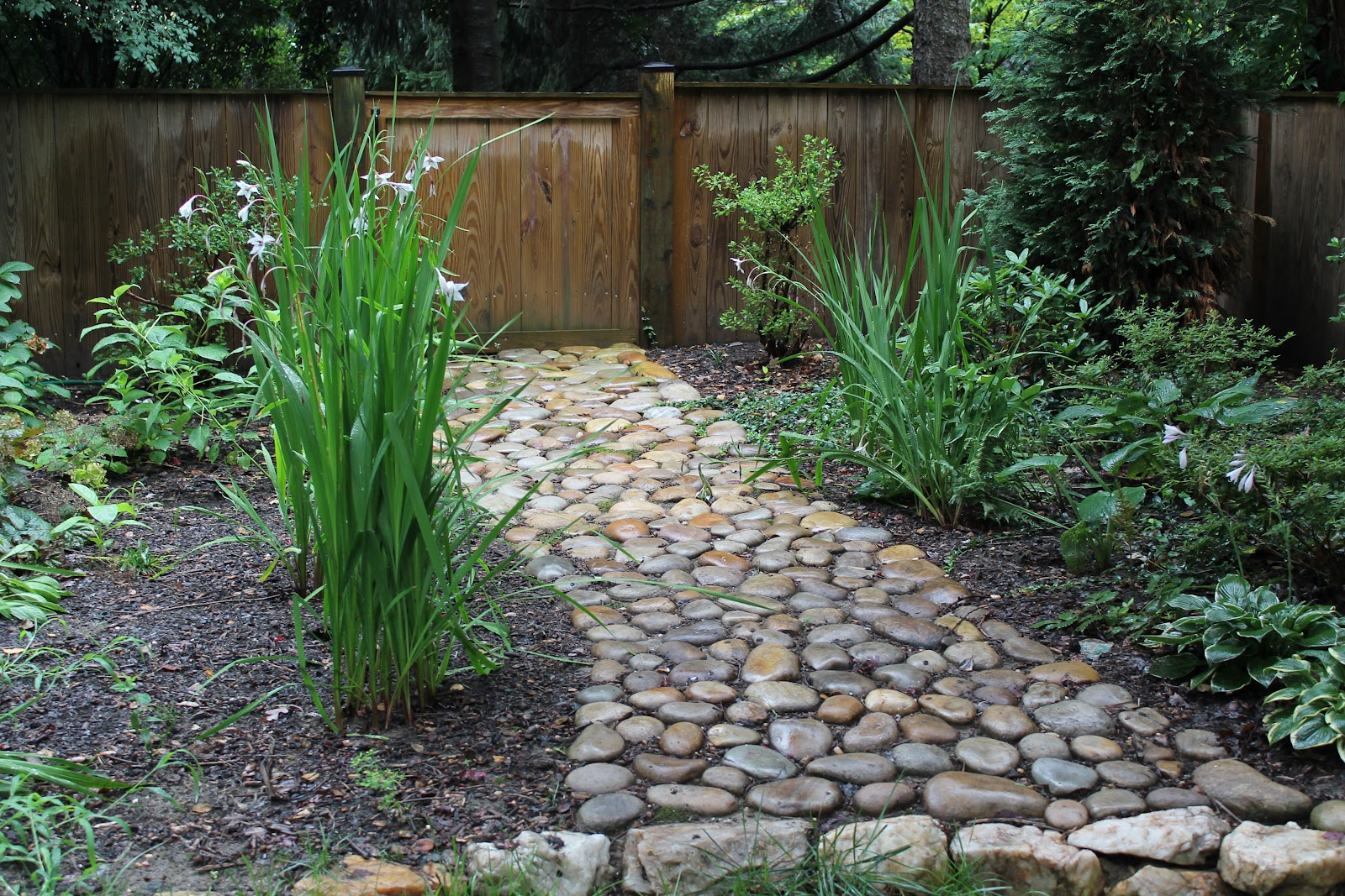 enhacing your landscape river rock garden path interior exterior