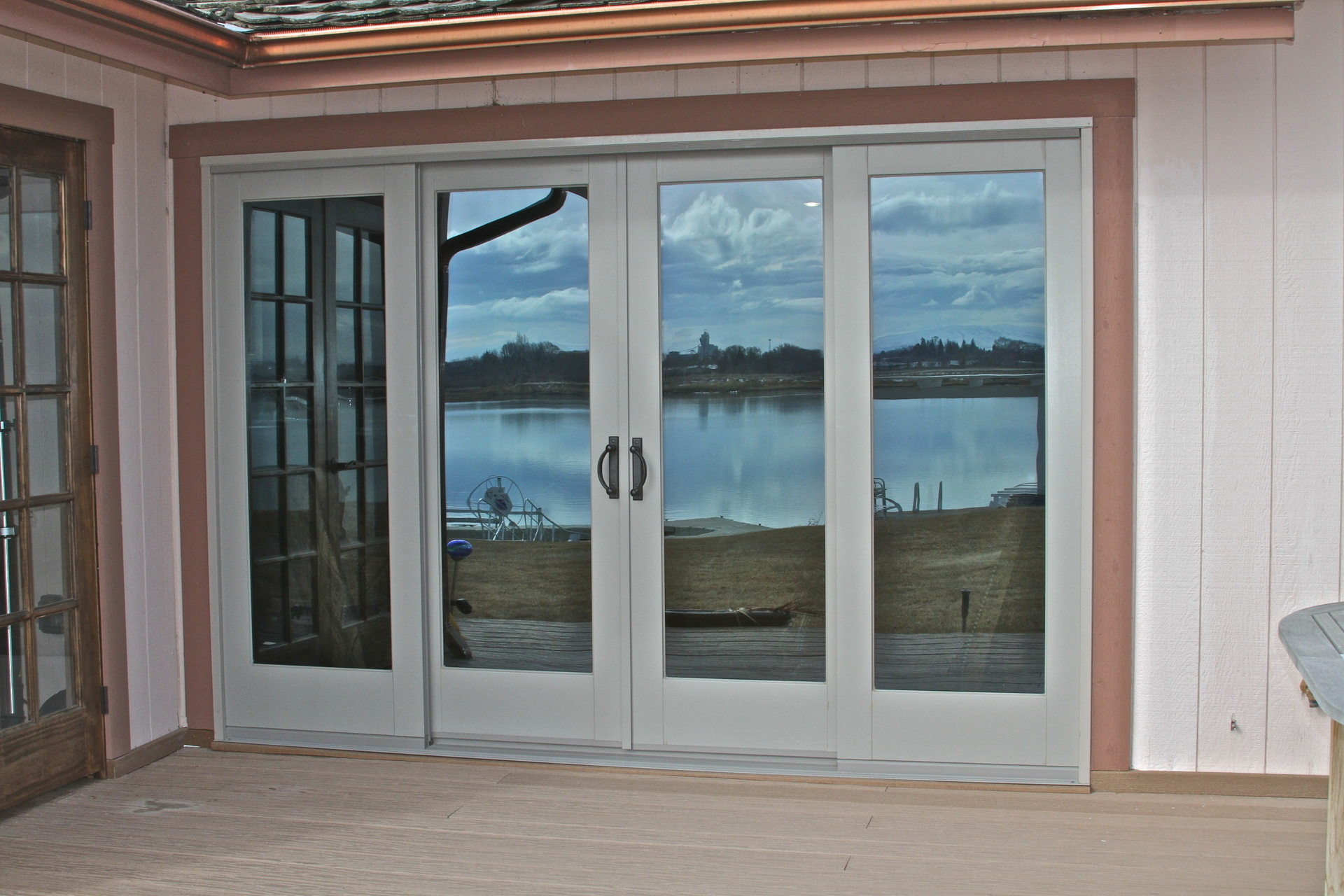 20 reasons to install french doors exterior andersen for Exterior door with sliding window