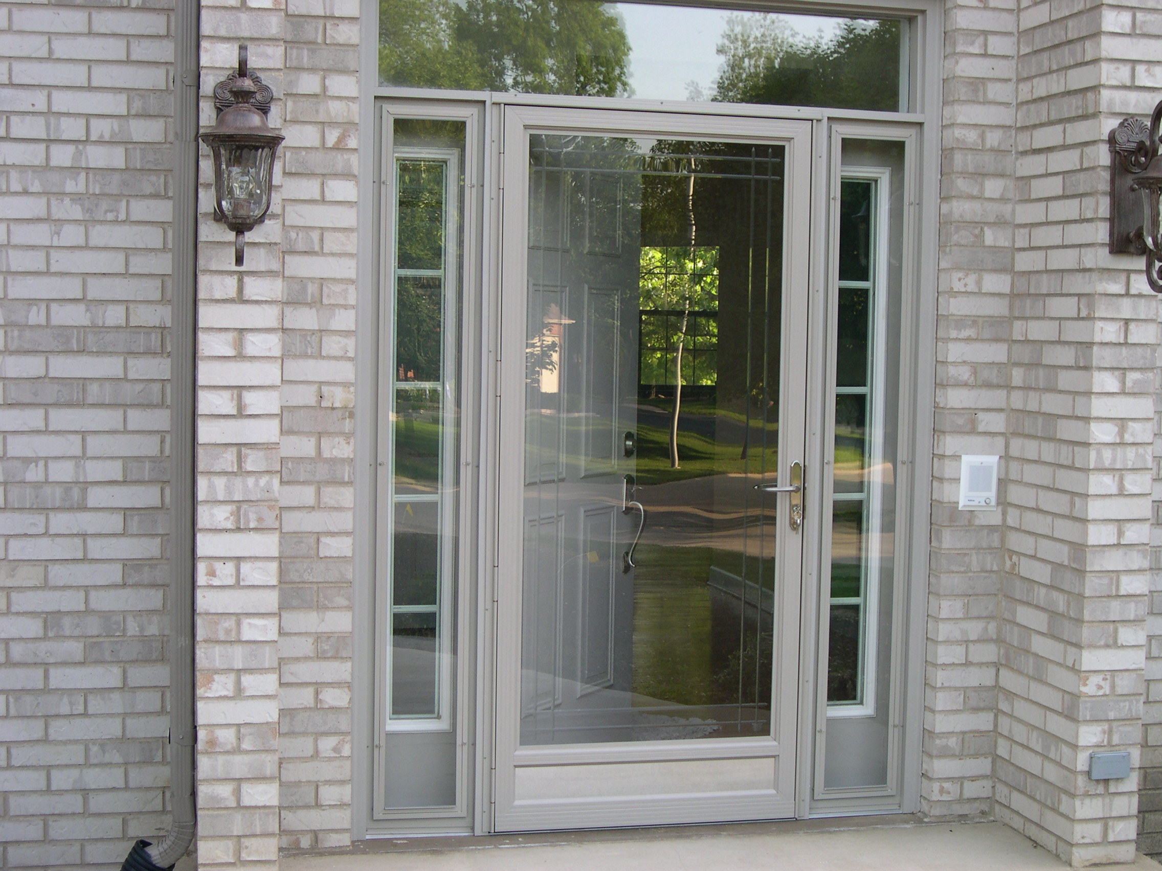 20 storm doors hardware storm doors with pet door for Screen doors for front door