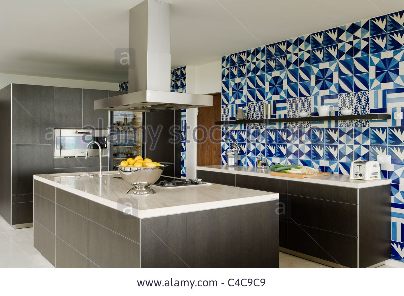White Kitchen with Dark Blue Tiling photo - 2