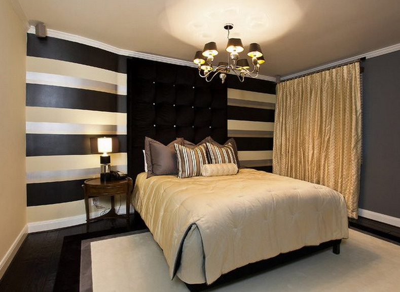 black and gold bedroom design giving a luxury themed