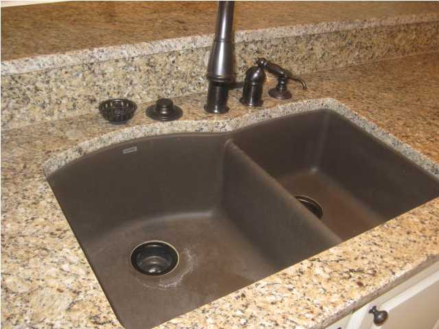black composite granite kitchen sink photo - 3