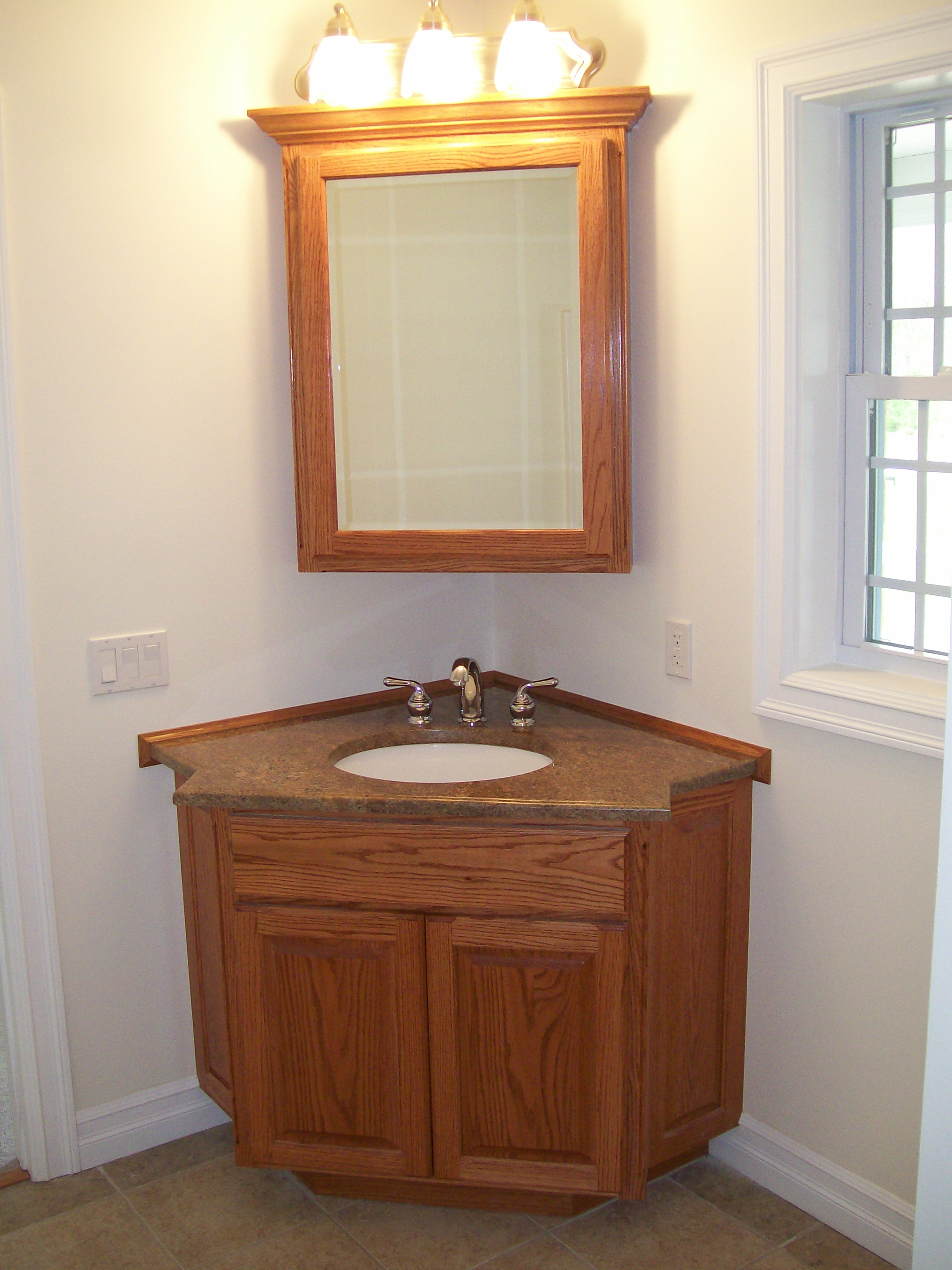 black granite corner sink photo - 3