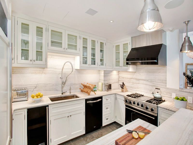 black kitchen cabinets and white appliances photo - 4