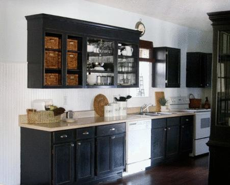 black kitchen cabinets and white appliances photo - 6