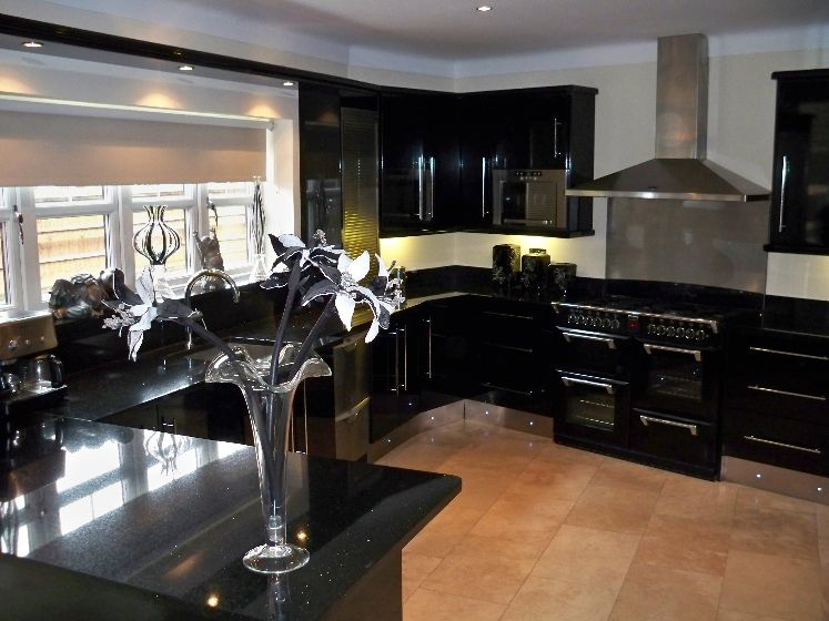 black kitchen cabinets in small kitchen photo - 6