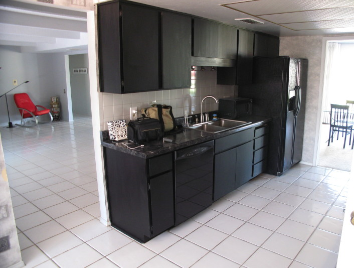 black kitchen cabinets with black appliances photo - 1