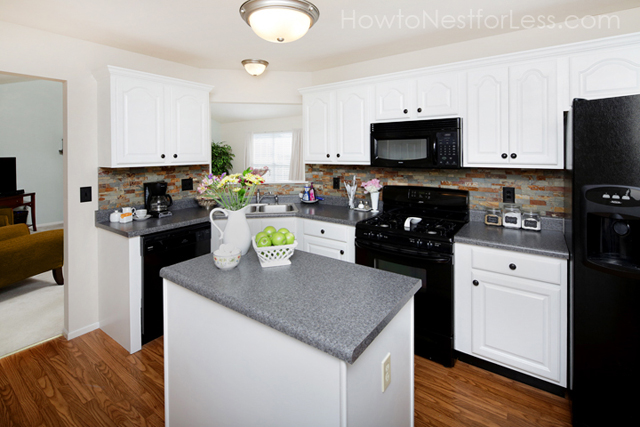 black kitchen cabinets with white appliances photo - 1