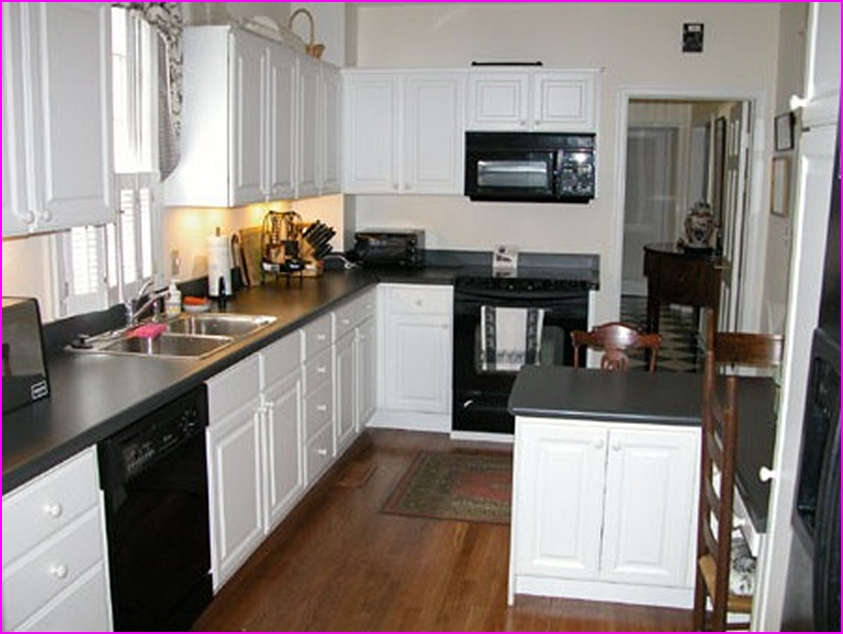 black kitchen cabinets with white appliances photo - 2