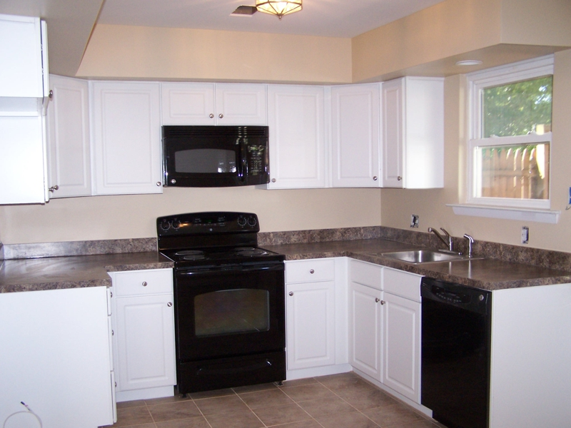 black kitchen cabinets with white appliances photo - 6