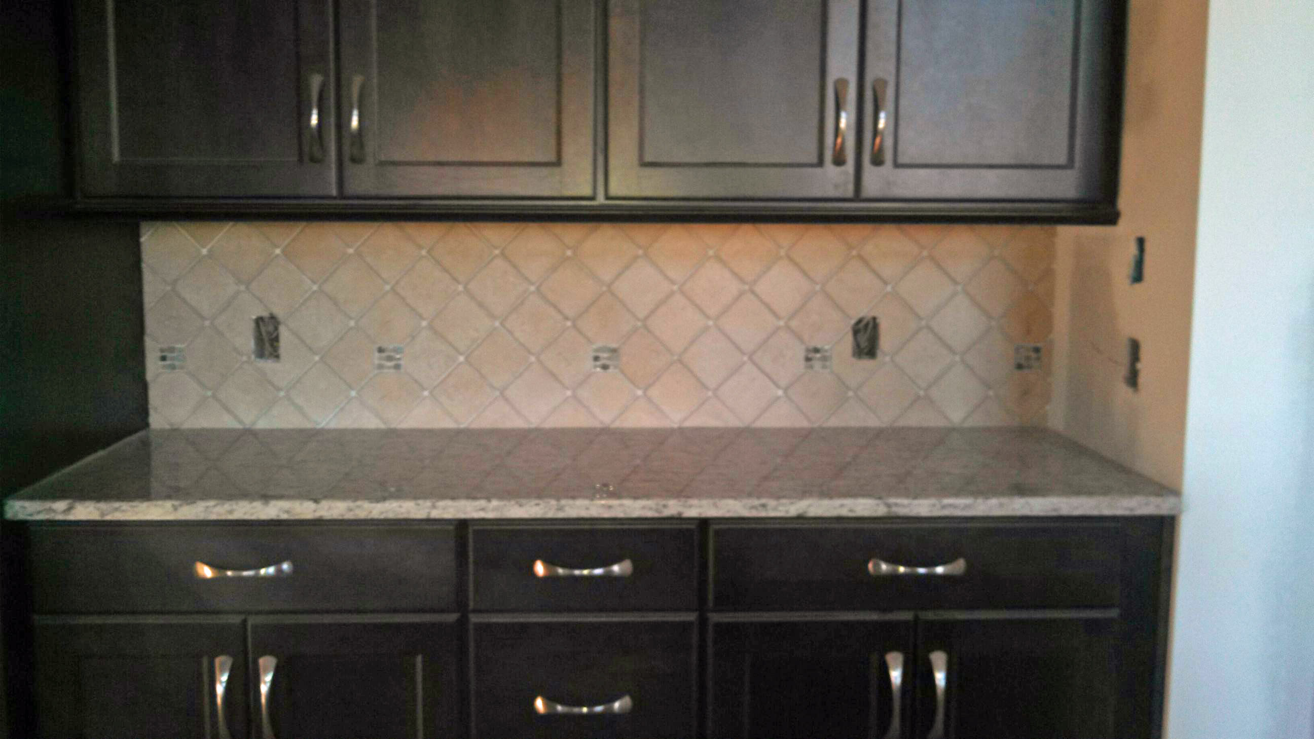 dark cabinets tile backsplash photo - 1