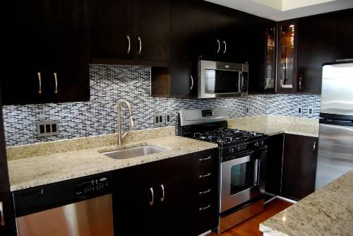 dark cabinets tile backsplash photo - 2