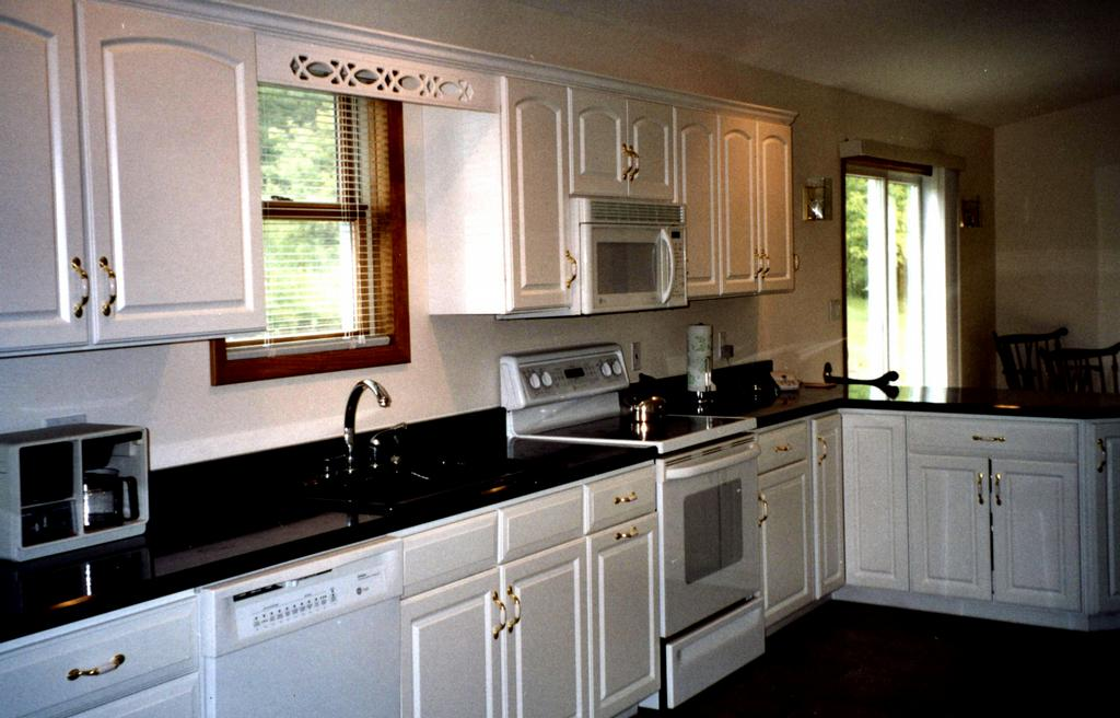 Black cabinets white granite granite countertops for your for Black kitchen cabinets with white marble countertops