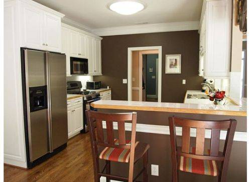 kitchen white cabinets brown walls photo - 1