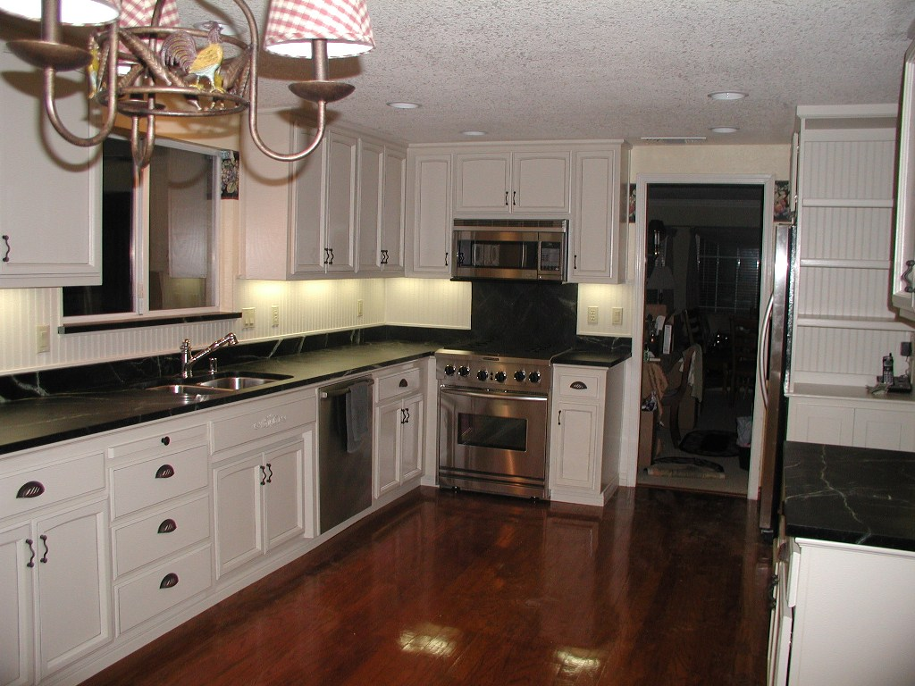 kitchen white cabinets dark countertops photo - 6