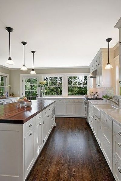 white cabinets with wood floors