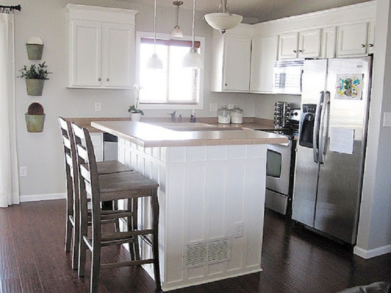 l shaped kitchen with white cabinets photo - 2