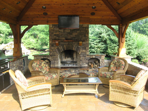 outdoor kitchen and fireplace photo - 2