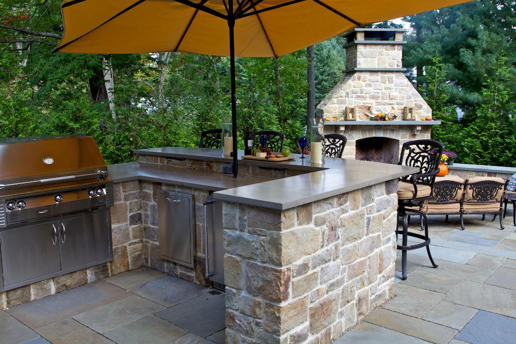 outdoor kitchen and fireplace photo - 3