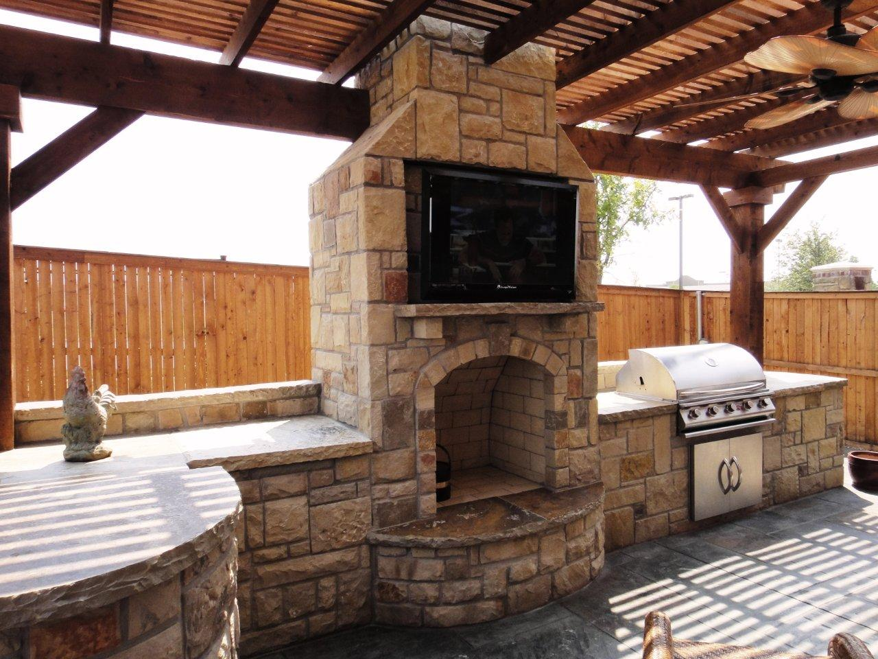 outdoor kitchen and fireplace photo - 4