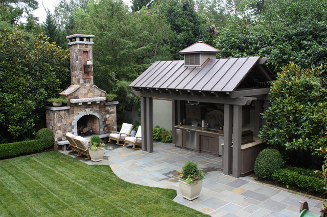 outdoor kitchen and fireplace photo - 6