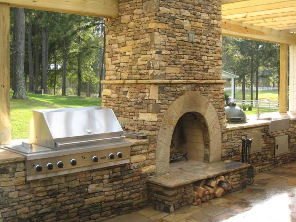 outdoor kitchen fireplace photo - 3