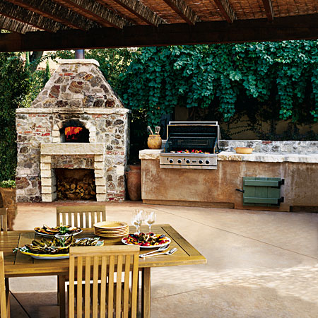 outdoor kitchen with fireplace photo - 2