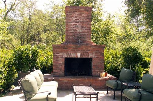 outdoor kitchen with fireplace photo - 4