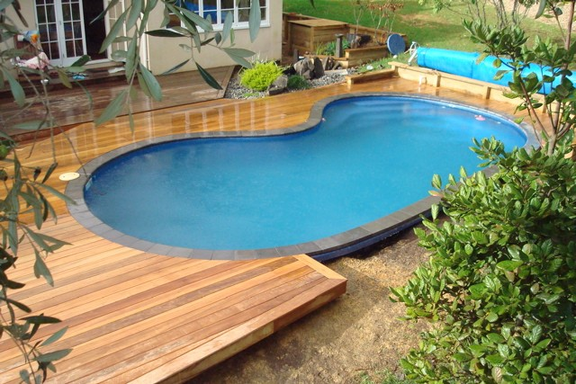 swimming pool designs with decking photo - 1