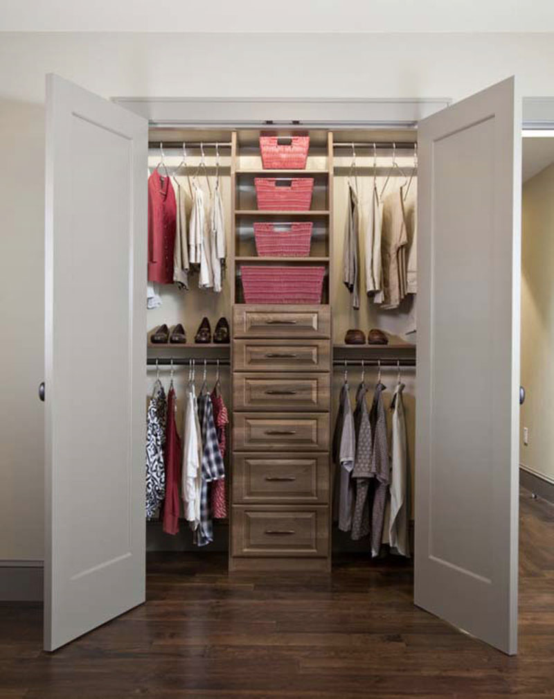 walk in closet in a small bedroom photo - 1